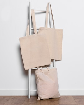 Tote bags arrangement on ladder indoors