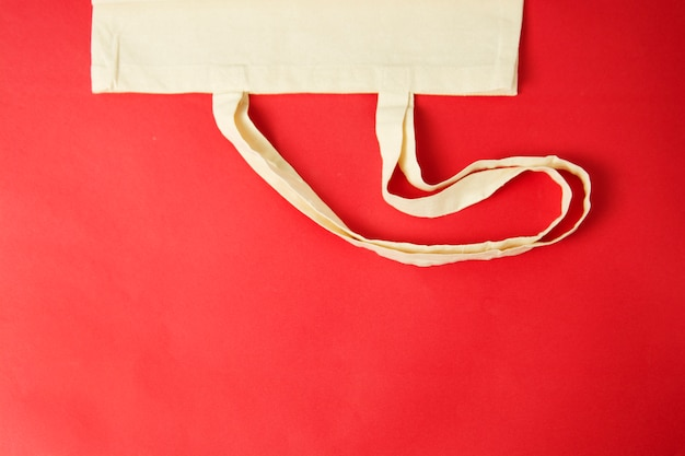 Tote canvas eco bag, shopping sack on colorful red background. zero waste concept.