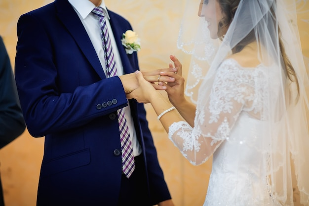 The touching moment of swapping wedding rings newlyweds