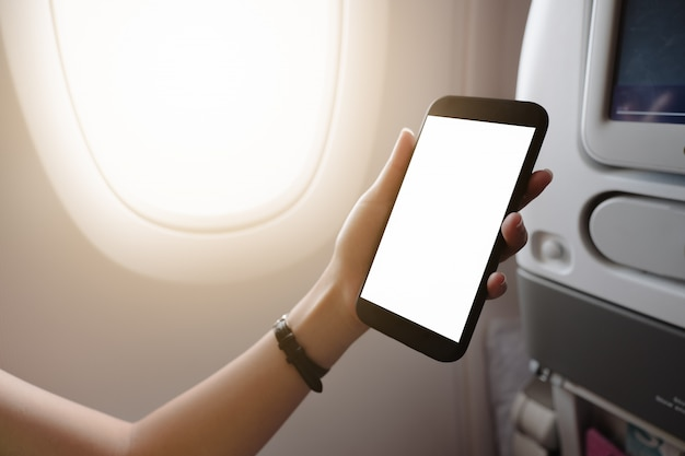 Touching and slide mobile phone screen on airplane or aircraft,blank mobile phone screen