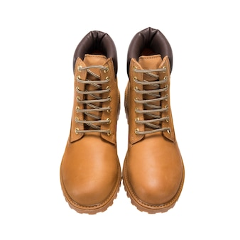 Touring light brown boots with lace-up tread isolated on a white surface