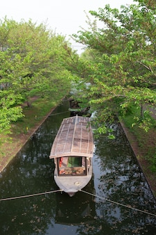 Touring shikara boat on a canal