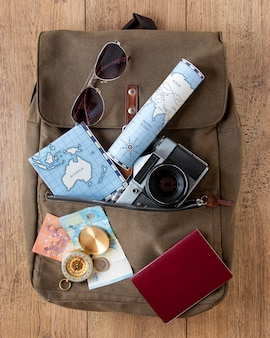 Tourism items assortment on wooden background