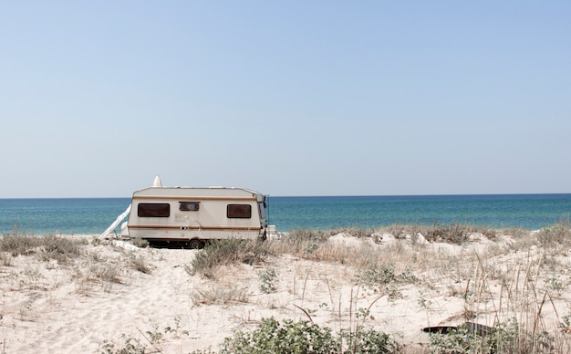 Tourism, leisure and travel. a tourist van and a sandy beach with a view of the black sea coast in the south of ukraine, kherson region. europe