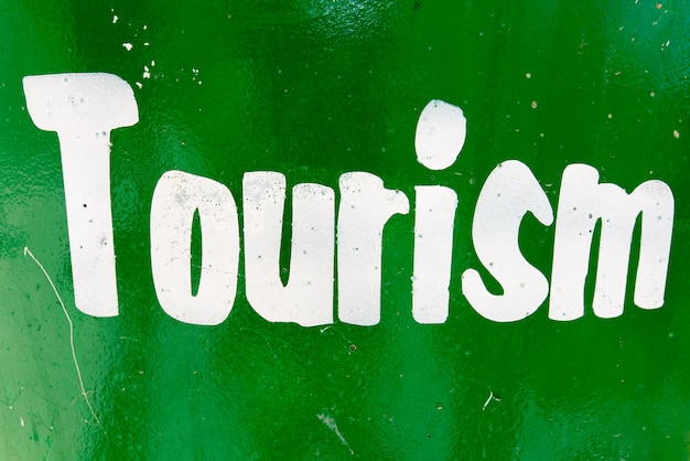 Tourism text printed in white on green
