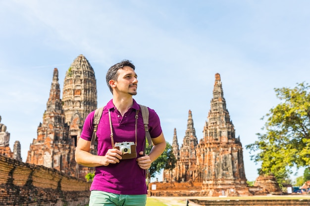 Tourist in ayutthaya, thailand, at historical park with ruins