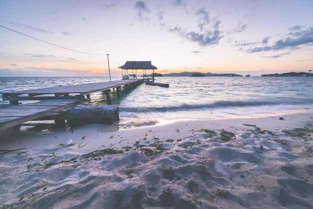 Tourist beach resort at dawn, marsala toned image
