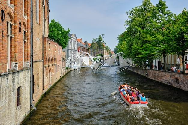 Tourist boat in canal brugge bruges belgium