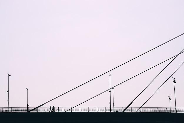 Tourist on the bridge visiting bilbao city, spain Premium Photo