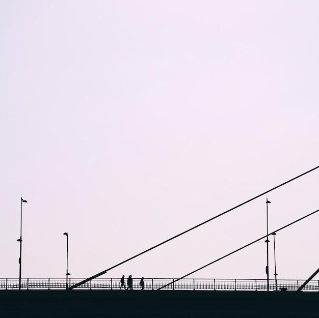 Tourist on the bridge visiting bilbao city, spain