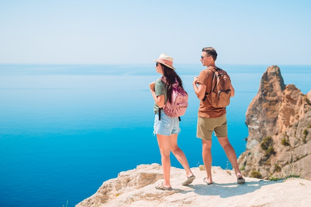 Tourist couple hiking on the summer vacation