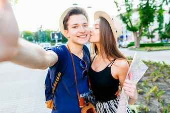 Tourist couple in park taking selfie