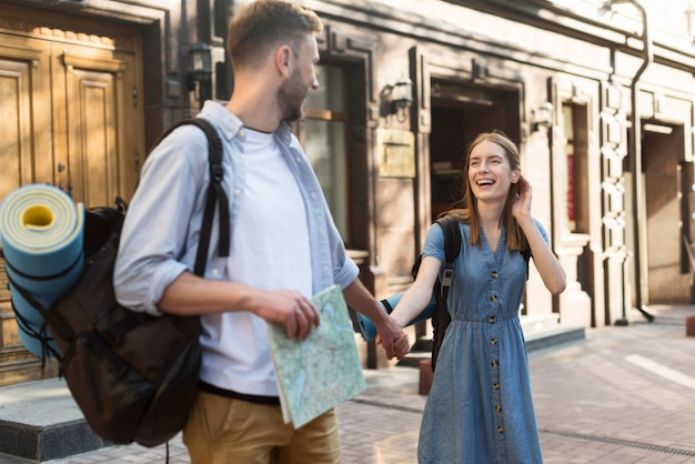 Tourist couple outside with map
