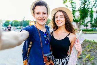 Tourist couple selfie in park