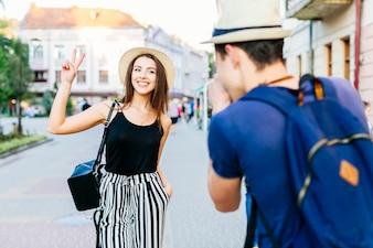 Tourist couple taking photo in city