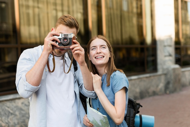 Tourist couple taking pictures with camera