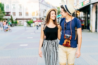 Tourist couple walking in city