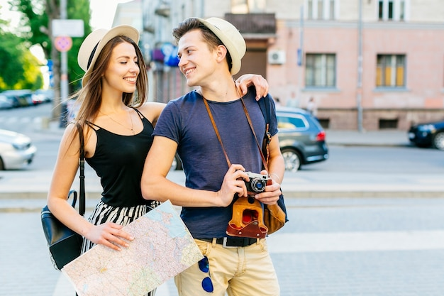 Tourist couple with map in city