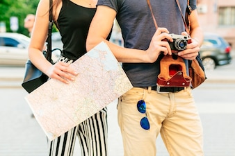Tourist couple with map