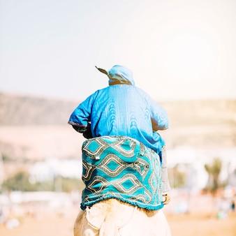 Tourist in desert landscape