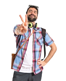 Tourist doing victory gesture
