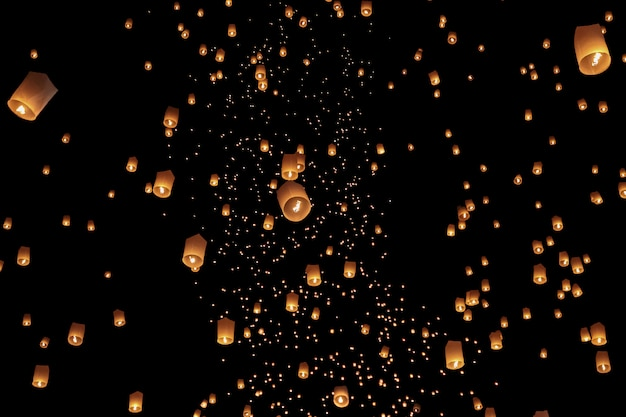 Tourist floating sky lanterns in loy krathong festival , chiang mai ,thailand