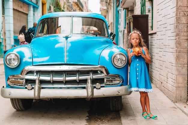 Tourist girl in popular area in havana, cuba. young kid traveler smiling