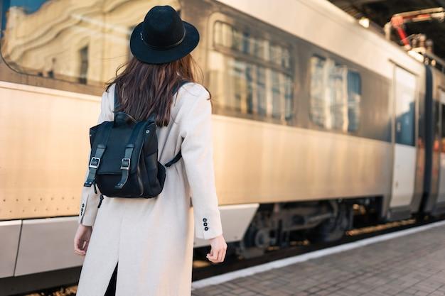 Tourist girl at railway station platform