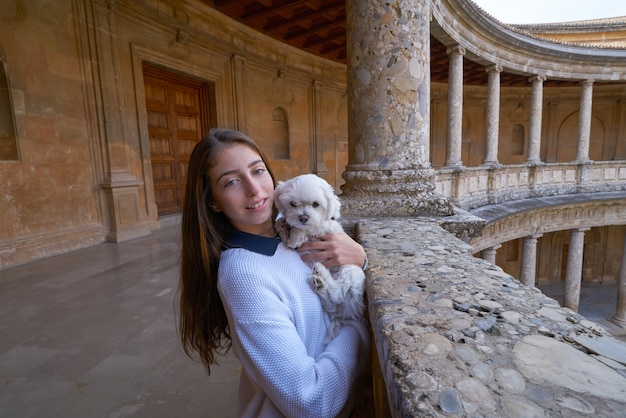 Tourist girl with pet doy in alhambra granada