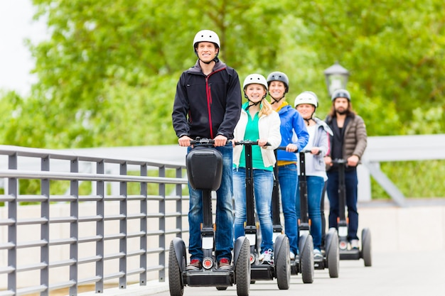 Tourist group driving segway at sightseeing tour