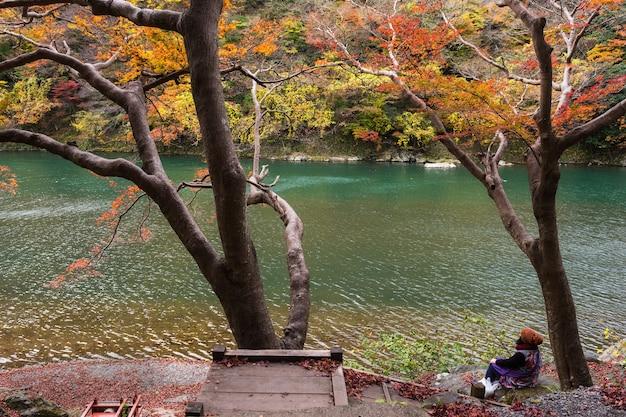 Tourist at katsura river  and enjoy autumn colors