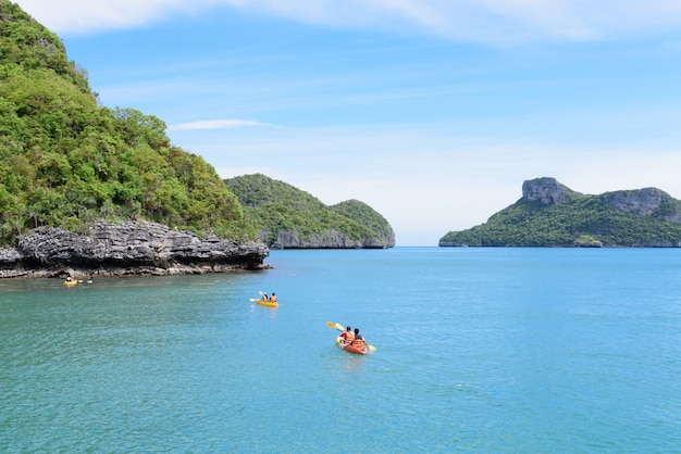 Tourist kayaking in the thai ocean from backward view