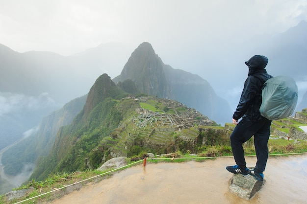 Tourist looking over machu picchu, peru