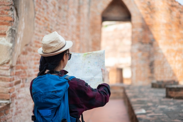 Tourist looking at map on the street, summer holidays sightseeing tourism