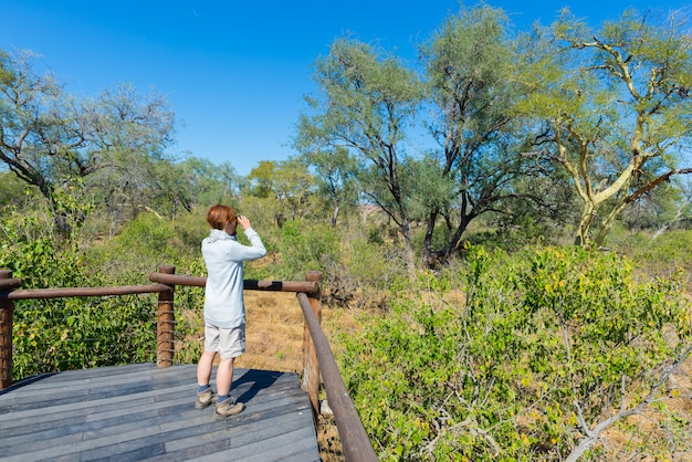 Tourist looking at panorama with binocular from viewpoint over the olifants river
