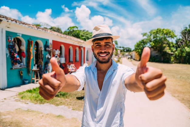 Tourist making selfie in the historic center of porto seguro