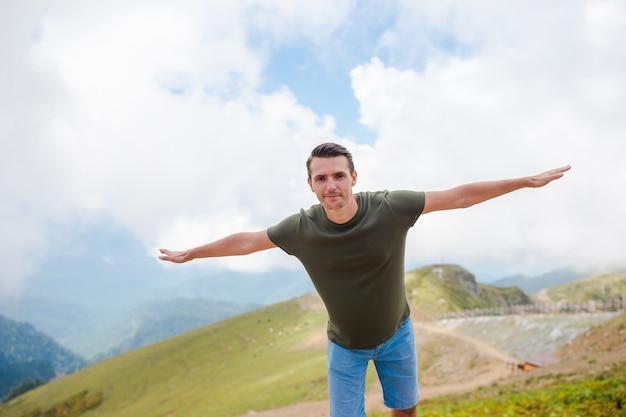 Tourist man in mountains
