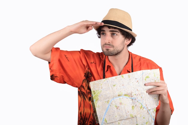 Tourist man with a city map on studio.