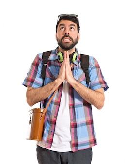 Tourist pleading over white background
