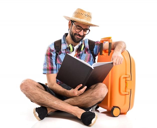 Tourist reading book