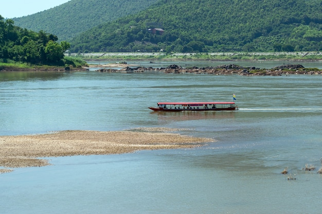 Tourist service boats are sailing in the middle of the mekong river in nong khai province of thailand.