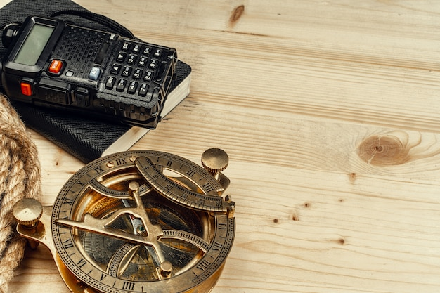 Tourist set with walkie talkie on wooden background