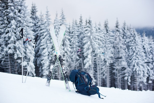 Tourist ski equipment laid out on snow on mountain descent