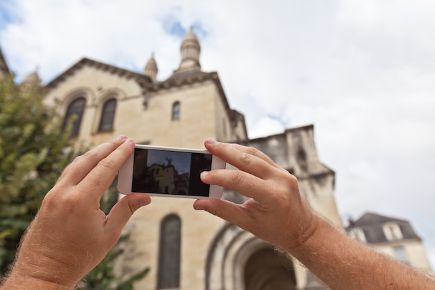 Tourist taking photo of a church