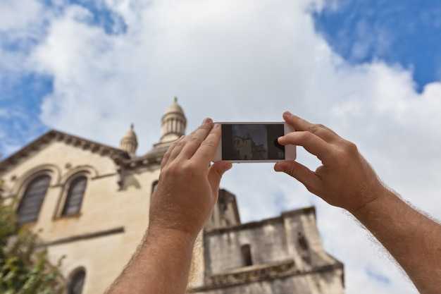 Tourist taking photo of perigueux, france Premium Photo