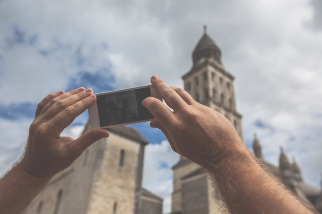 Tourist taking photo of perigueux, france Premium Photo