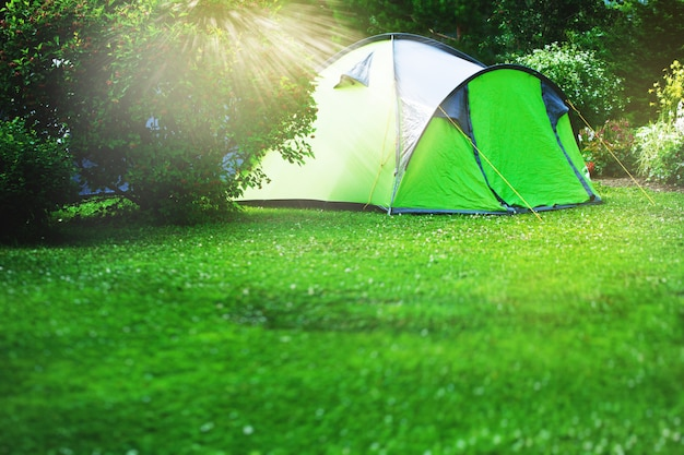 Tourist tent on green meadow
