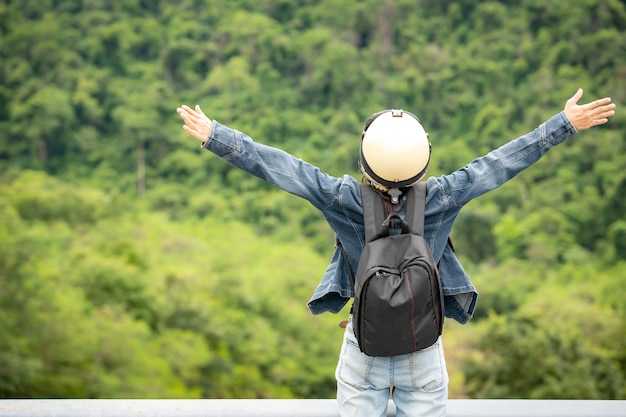 Tourist travel relax on vacation summer on dam of river on mountain sky and cloud