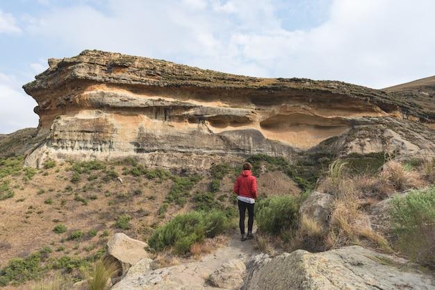 Tourist trekking on trail in the golden gate highlands national park