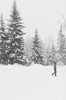 Tourist walking on snowy woods